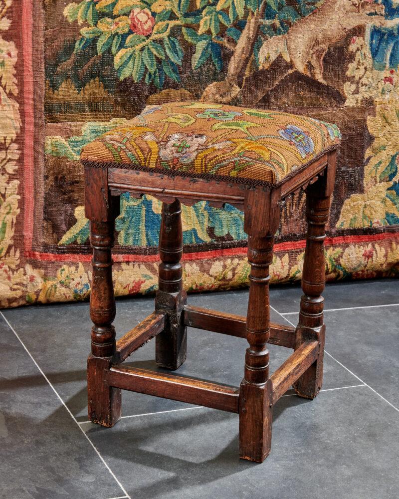 Charles II oak upholstered stool