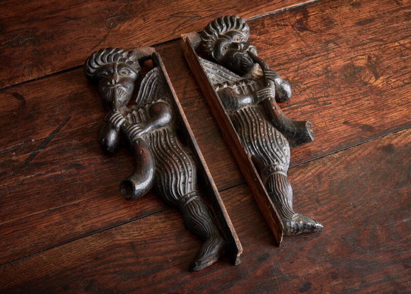 James I oak carved flute players