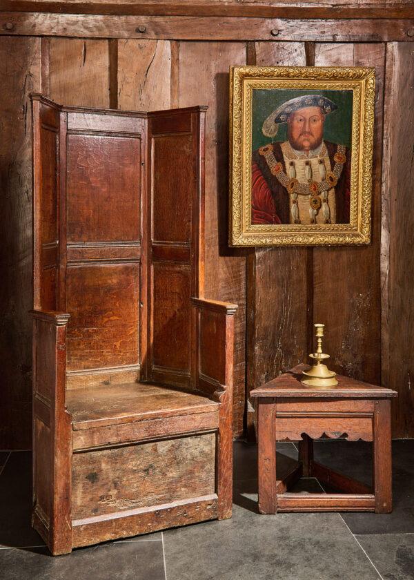Henry VIII oak panelled box seat armchair