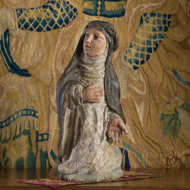 Renaissance kneeling nun