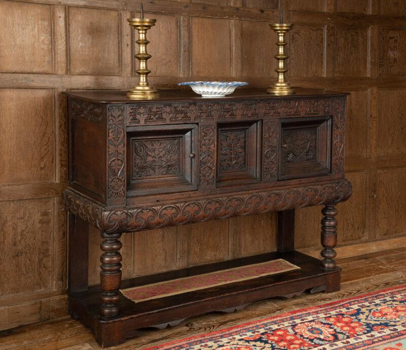Charles I oak carved livery cupboard